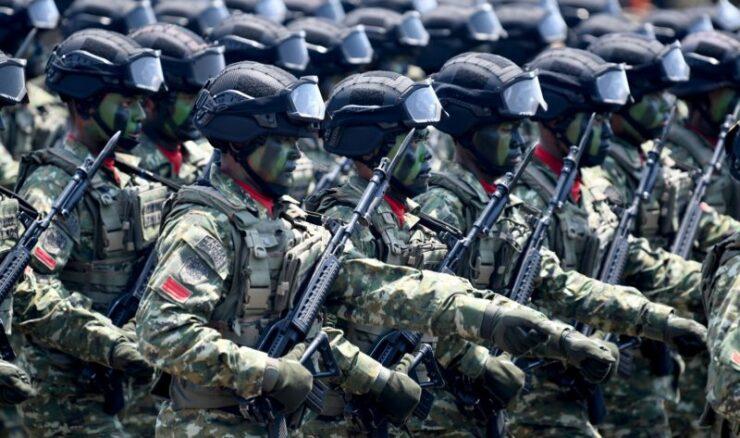 Prajurit TNI AD Mengikuti Defile Saat Upacara Perayaan HUT Ke 74 TNI Di Lanud Halim Perdanakusuma, Jakarta Timur, Sabtu (5/10/2019)