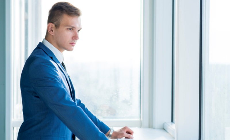 Side View Young Businessman Standing Near Window Office 23 2147899571