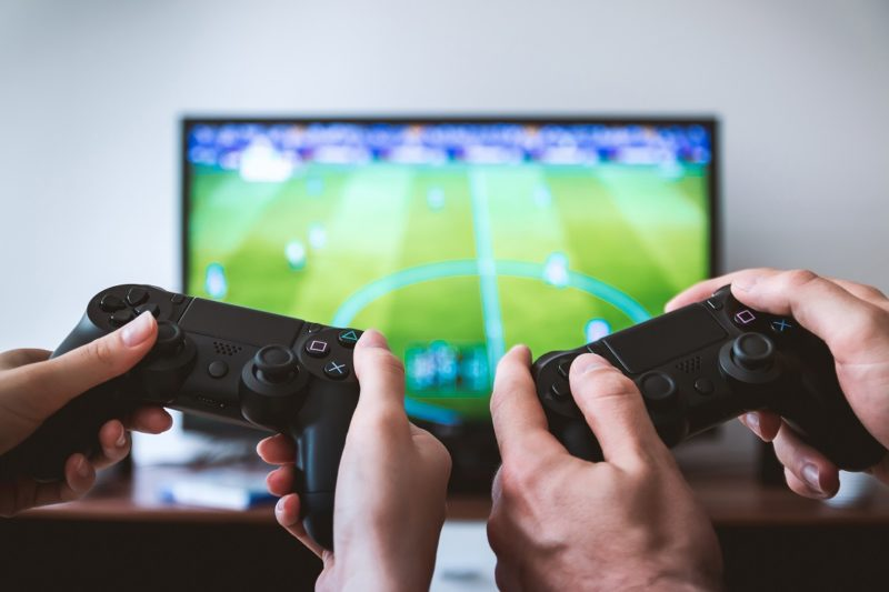 Two Players Playing Video Games On Tv At Home