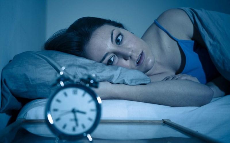 Woman Wide Awake Looking At Alarm Clock1