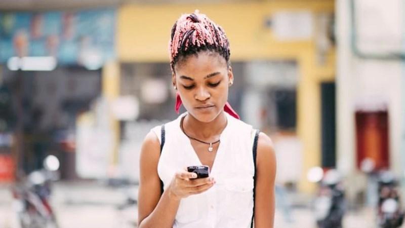 Black Woman Looking At Phone1