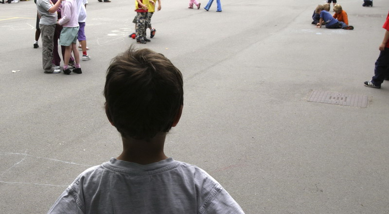 A Child Alone In A School Playground