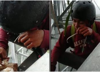 Demi Sesuap Nasi, Pekerja Ini Hujan Hujanan Sambil Makan Di Atas Tower, Bikin Ngeri